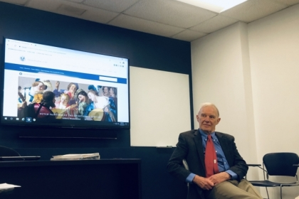Art Historian Arthur Wheelock sits in front of a UW1020 class giving a lecture.